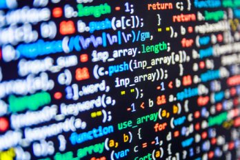 Close-up, shallow-depth of field, angled, image of programming code displayed on computer screen. From https://www.hindscc.edu/Assets/images/computer-programming-tech.jpg